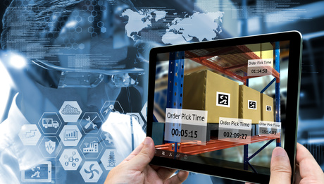 Industry 4.0 , Augmented reality and smart logistic concept. Hand holding tablet with AR application for check order pick time in smart factory.Man use AR glasses and industry infographic background.